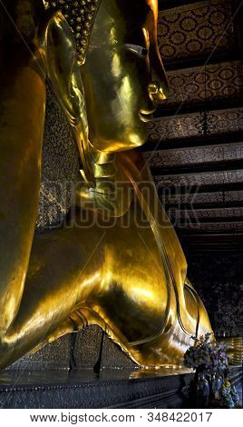 Bangkok / Thailand - January 14, 2020: Sleeping Buddha Gold Statue Face In Wat Pho Temple.
