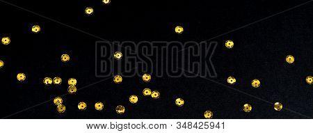 Golden Paillette Glitter On Black Background. Festive Holiday Bright Backdrop. Social Media Banner O