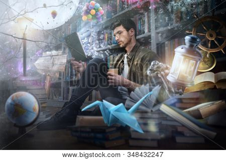 Boy Reads A Book At Night In A Library. Concept Of Fantasy, Imagination And Creativity