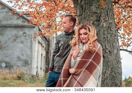 Modest Couple In Love On A Tree In The Open Air On An Autumn Day Stand Shyly Nearby, The Beginning O