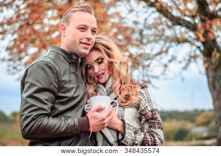 Happy Romantic Couple In Love Outdoors Warming Themselves Up With Tea On A Cold Autumn Day, The Girl