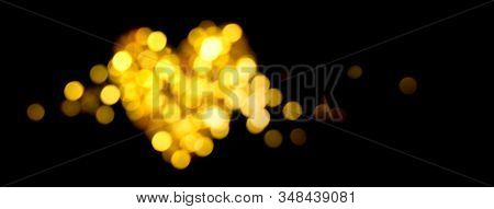 Defocused Shiny Heart Shape. Holiday Bokeh Golden Lights Background. Festive Backdrop. Social Media