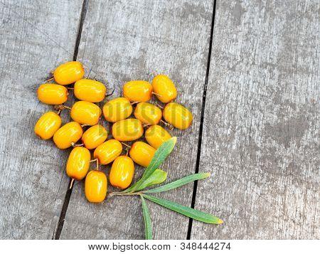 Ripe Orange Sea-buckthorn Berries In A Heart Shape On Rustic Weathered Wooden Table. Hippophae Rhamn