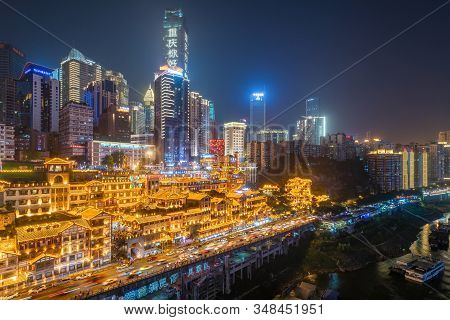 Chongqing, China - June 12, 2018 : Chongqing Skyline At Night With Hongyadong Cave In The Foreground
