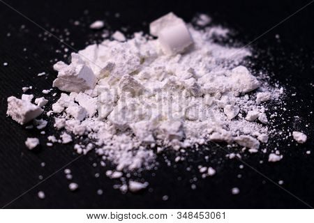 Powder From Drugs On A Black Background. The Concept Of Illicit Trade In Narcotic Drugs.