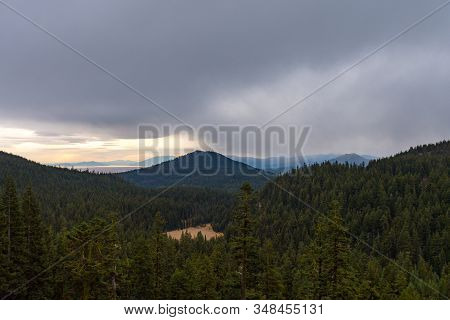 Forest And Mountain Landscape On A Rainy Day Seen From Crater Lake, Oregon, Usa