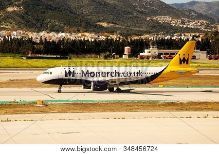 Malaga, Spain - March 18, 2013 - Monarch Airlines Airbus A320 Taxiing At The Airport, Malaga, Spain,