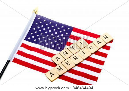 The Flag Of The United States Isolated On A White Background With A Sign Reading Anti American