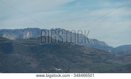 View Of El Totcal Mountain Range Across Guadalhorce Valley From Andalusian Village Of Alora