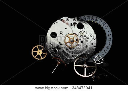 Watch Parts On A Black Background . Small Detail Mechanical Clock Close-up. Time Stopped