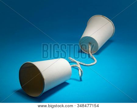 Two white paper cup connect with rope used for classic phone , For old communication system concept