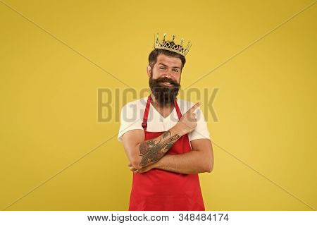 Royal Recipe. Man King Cook Wear Cooking Apron And Golden Crown. Kingdom Of Tastes. Chief Cook And P