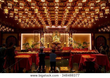 Singapore-november 26, 2019: Buddha Statue Sitting On Lotus Inside The Buddha Tooth Relic Temple. Si