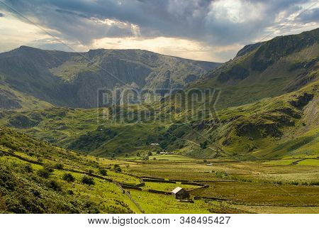 View Toward The Glyderau Mountain Range Along The Nant Ffrancon Pass In Snowdonia National Park In N