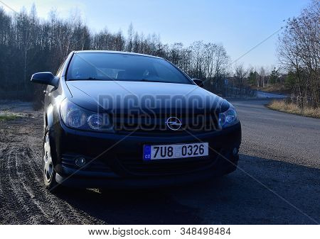 Ervenice, Czech Republic - January 21, 2020: Black Car Opel Astra H Stand On Road In Winter Nature