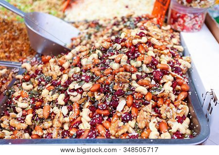 Background Of Mix Of Nuts With Sesame Seeds, Seeds And Dried Cranberries At The Mahane Yehuda Market