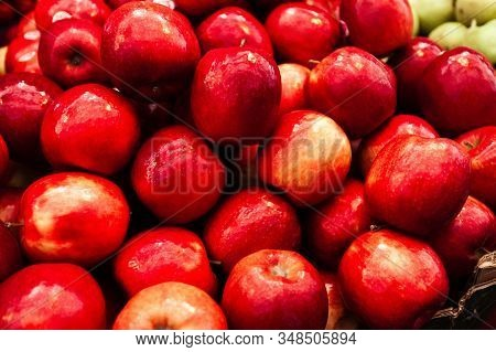 Background From A Group Of Red Apples On A Counter At The Mahane Yehuda Market In Jerusalem, Israel