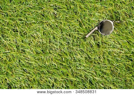 Soccer Sports Silver Chrome Whistle On Grass Background - Penalty, Foul Or Sports Concept, Top View