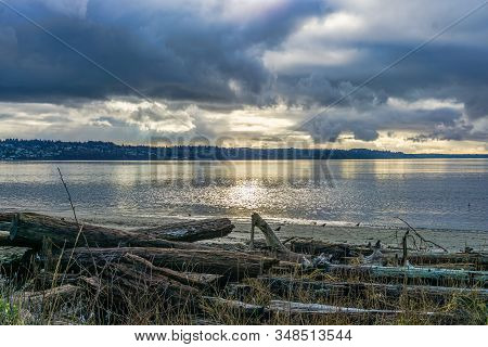 A View Of The Puget Sound On A Cloudy Day At Salwater State Park In Washington State.
