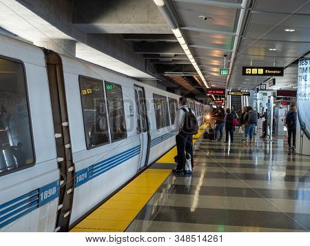 San Francisco, Ca July 17, 2018: Bart Bay Area Rapid Transit Train With Passengers Boarding At Sfo S