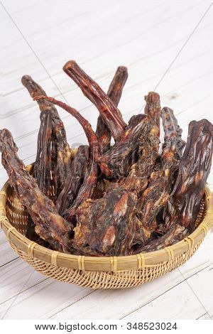 Straw Bowl Full Of Dried Oxtails. Could Be Used In Exotic Cuisine Or As Natural Chew Treats For Big