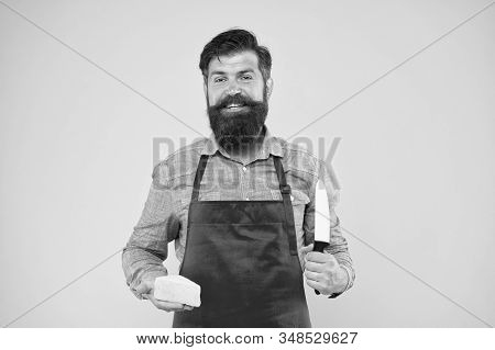 Ready For Eating. Cheesemaking Concept. Cheese Maker Own Business. Hipster With Beard In Chef Apron.