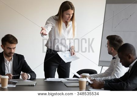 Female Boss And Employee Having Conflict During Meeting In Boardroom