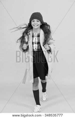 Happy Walk. Fashion Accessory. Fancy Schoolgirl. Girl Little Fashionable Pupil Wear Knitted Hat And