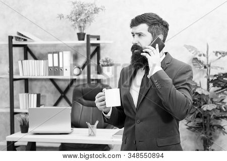 Man Bearded Businessman Hold Cup And Smartphone. Coffee Is Pledge Of Successful Negotiations. Caffei