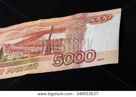 One Russian Bill In The Amount Of 5000 Rubles Lies On The Back On A Black Background.