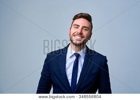 Portrait Young Smiling Businessman. Caucasian Guy Business Suit Studio Gray Background. Modern Busin