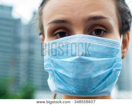 Portrait of a woman in a medical mask protecting against the 2019-nCoV virus epidemic
