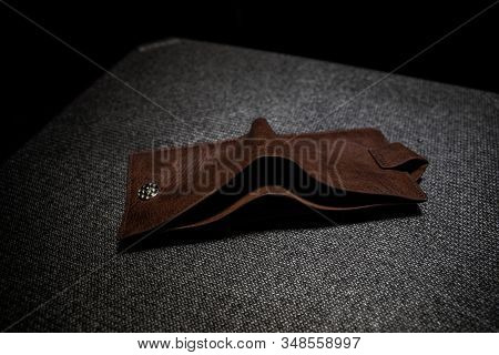 Old Leather Empty Wallet On Wooden Table. Concept Of Financial Assets, Reliability Deposits, Insuran