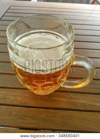 Half a litre of Beer in a glass