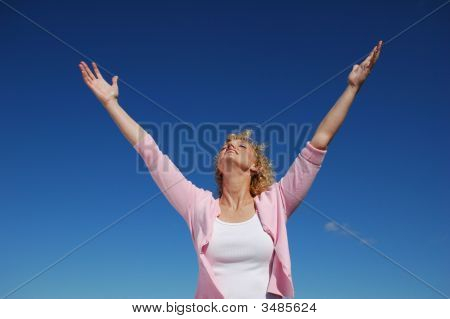 Woman With Her Arms Wide Open