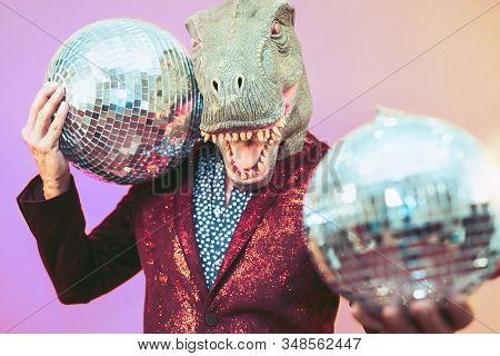 Senior Man Having Fun Wearing T-rex Mask In Discotheque - Elegant Dinosaur Masquerade Male Celebrati