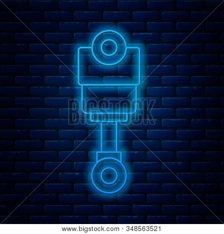 Glowing Neon Line Engine Piston Icon Isolated On Brick Wall Background. Car Engine Piston Sign. Vect