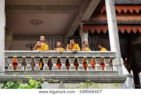 Siem Reap, Cambodia - 5 April 2013: Smiling Monks On A Balcony Of A Monastery In Siem Reap, Cambodia