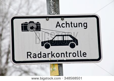 German Language Radar Control Sign Warning Car Drivers About Speed Control. Text Translation