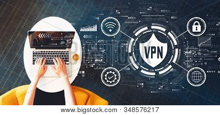 Vpn Concept With Person Using A Laptop On A White Table