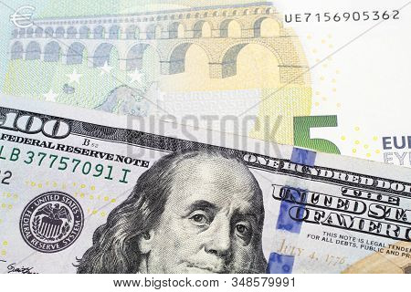 A Close Up Image Of A One American One Hundred Dollar Note Close Up In Macro With Blue And Green Fiv