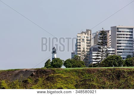 Miraflores, Lima, Peru - May 10, 2016: View Of La Marina Lighthouse From Across The Cliffs In Mirafl