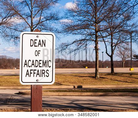 Dean Of Academic Affairs Sign Outside In A Parking Lot On A Sunny Winter Day