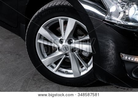 Novosibirsk, Russia - December 01, 2019:  Nissan Teana, Close-up Car Wheel With Aluminum Alloy Wheel