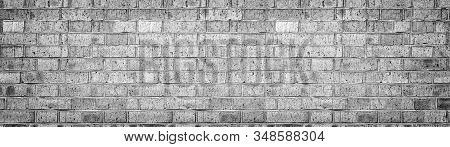 Wide Gray Brick Wall Texture. Rough Light Grey Brickwork. Old Cracked Blocks Panorama. Retro Grunge