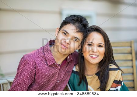 Portrait Of An Asian Mother With Her Teenage Son.