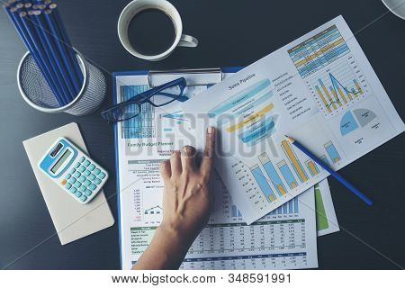 Excel Spreadsheet Stats Graph Analytics Data. Accountant Hands Holding Financial Document Trading In