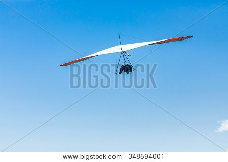 Extremal Air Sports Competition - Hang Gliding. Overhead View Of The Soaring Hang Gliding Pilot Agai