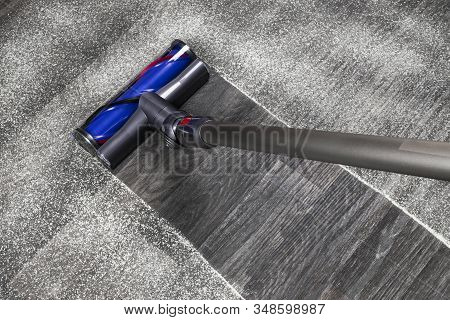 Vacuum Cleaner On The Floor. House Cleaning Concept. Before And After Cleaning. Dirty And Cleaned Ar