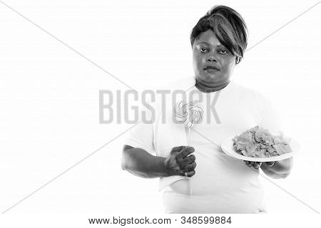 Studio Shot Of Overweight African Woman Ready For Gym
